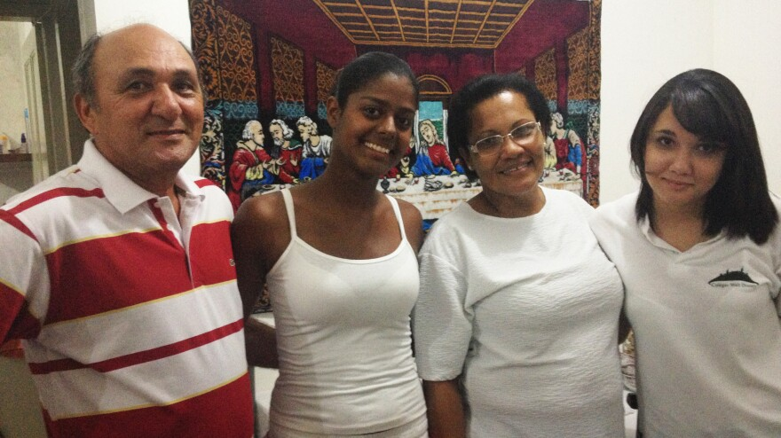Roberto de Carvalho (left), who maintains a truck fleet in Recife, Brazil, is shown here with his daughter Sandra, 22, wife Enilda and daughter Susana, 16. The family makes just enough to belong the rapidly expanding ranks of the country's middle class, though they still can't afford a house or even a car.