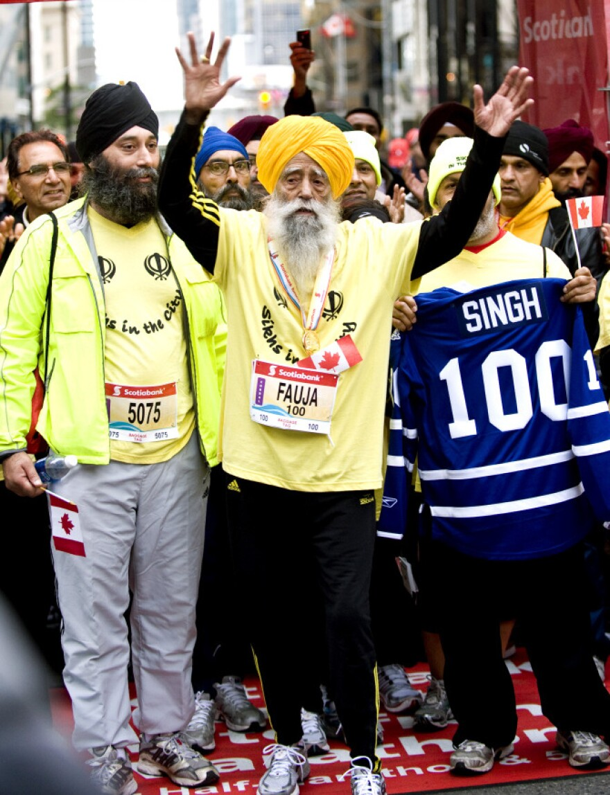 <p>Fauja Singh, 100, celebrates at the finish line after completing the Toronto Waterfront Marathon in Toronto on Sunday, Oct. 16, 2011.</p>