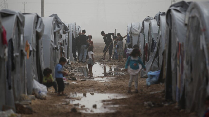 Syrian Kurdish refugees who fled Kobani make do in a refugee camp in Suruc, on the Turkey-Syria border on Saturday. The Syrian Kurdish border town of Kobani and its surrounding areas have been under assault by the so-called Islamic State since mid-September.