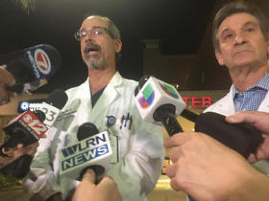From left, Benny Menendez and Louis Yogel are directors of Broward Health Medical Center's emergency department and medical staff, respectively. They briefed reporters on the condition of shooting victims during a news conference outside the hospital on Feb. 14.