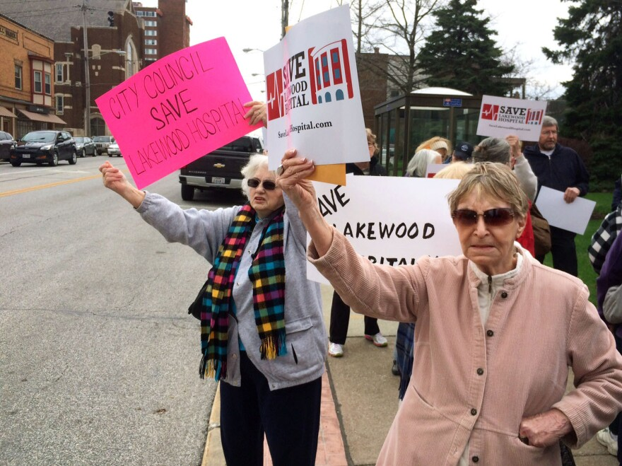 "Ann Allen (right) and Marie Birsic (left) take part in a demonstration to prevent the closure of Lakewood Hospital on Cleveland's West Side. Birsic says the neighborhood will ""go down into a ghost town"" once the hospital is turned into an outpatient center."