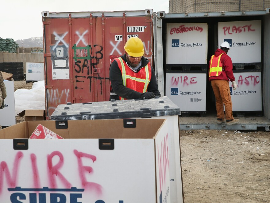 A shipping container is filled with excess equipment and supplies  in March as the U.S. military draws down in Afghanistan.