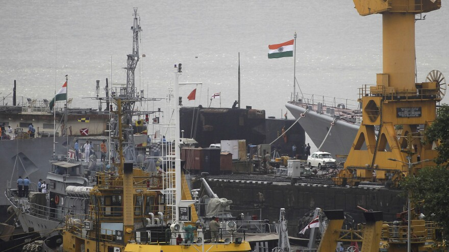 A general view of a naval dockyard where a submarine caught fire and sank after an explosion early Wednesday in Mumbai, India.