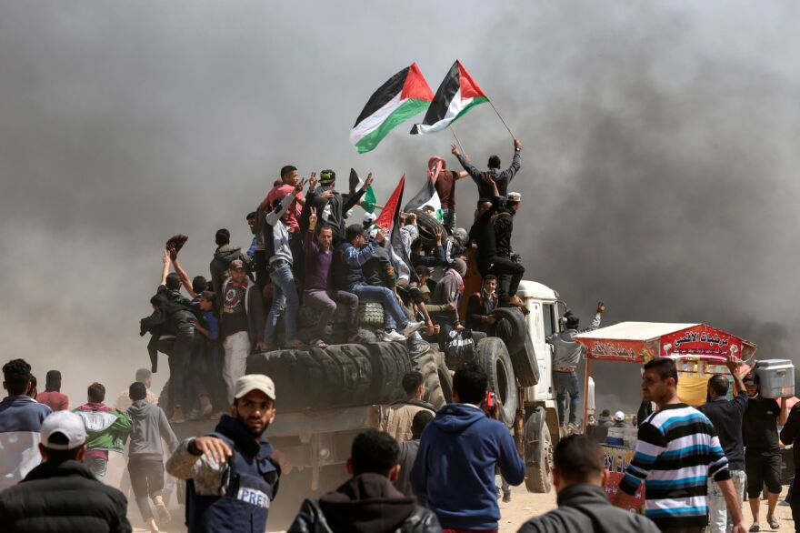 Palestinian demonstrators burned tires in order to create a smoke screen to block the view of Israel forces.