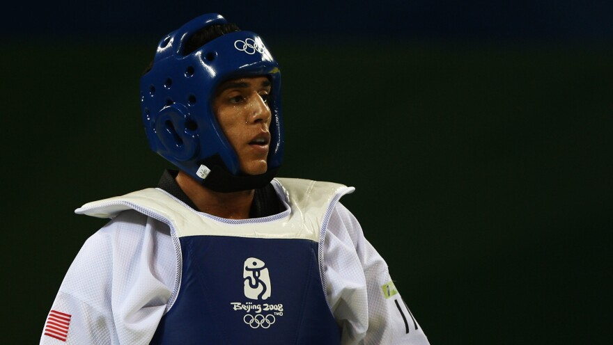 Steven Lopez represents the United States at the 2008 Olympic Games in Beijing.