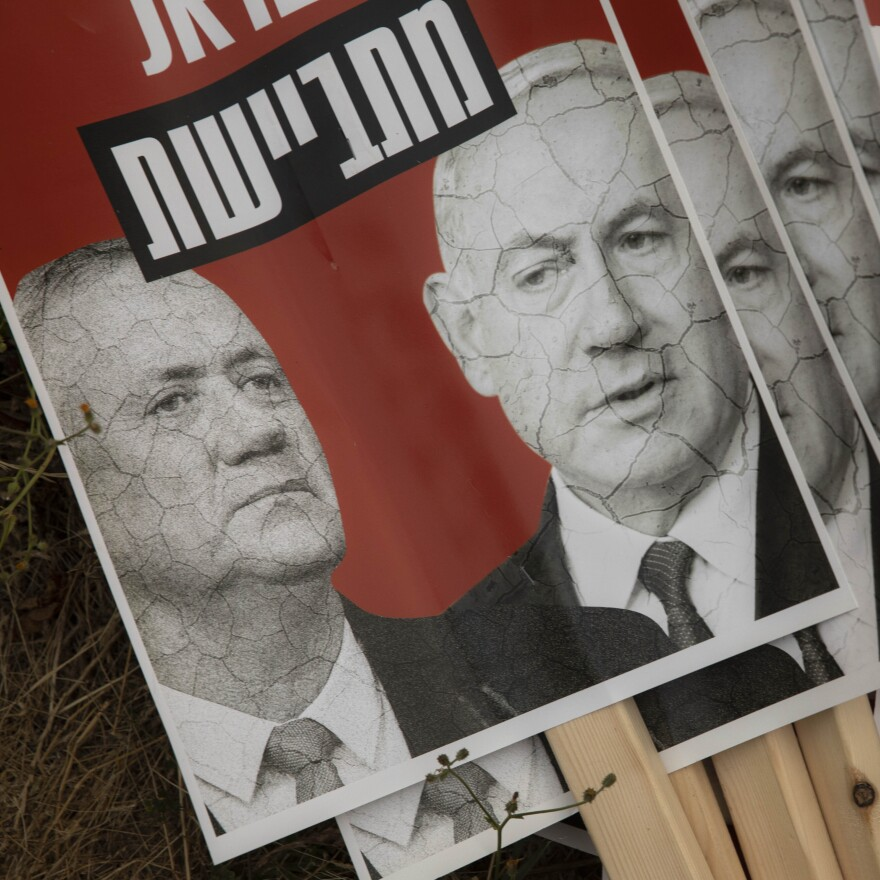 """Signs depicting Israeli Prime Minister Benjamin Netanyahu and Blue and White party leader Benny Gantz, seen during a demonstration outside the Knesset, Israel's parliament, last Thursday. The sign reads """"Israel is ashamed."""""""