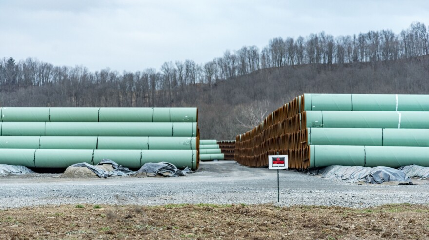 Sections of pipe sit in a storage yard outside Buckhannon, W.Va.