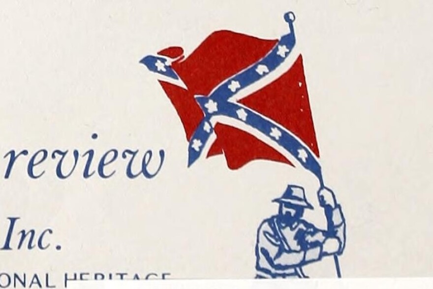 A stylized, two-tone stamp of a man waving the battle flag of the Army of Northern Virginia, commonly known as the Confederate flag.