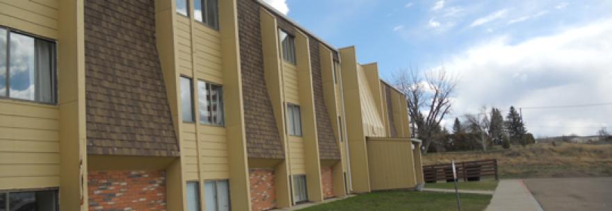 A tan housing complex