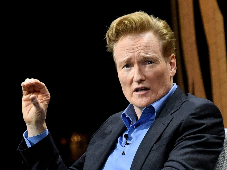 Late night TV host Conan O'Brien, pictured in 2016, has settled a lawsuit with a man who accused O'Brien and his writing staff of stealing his jokes.