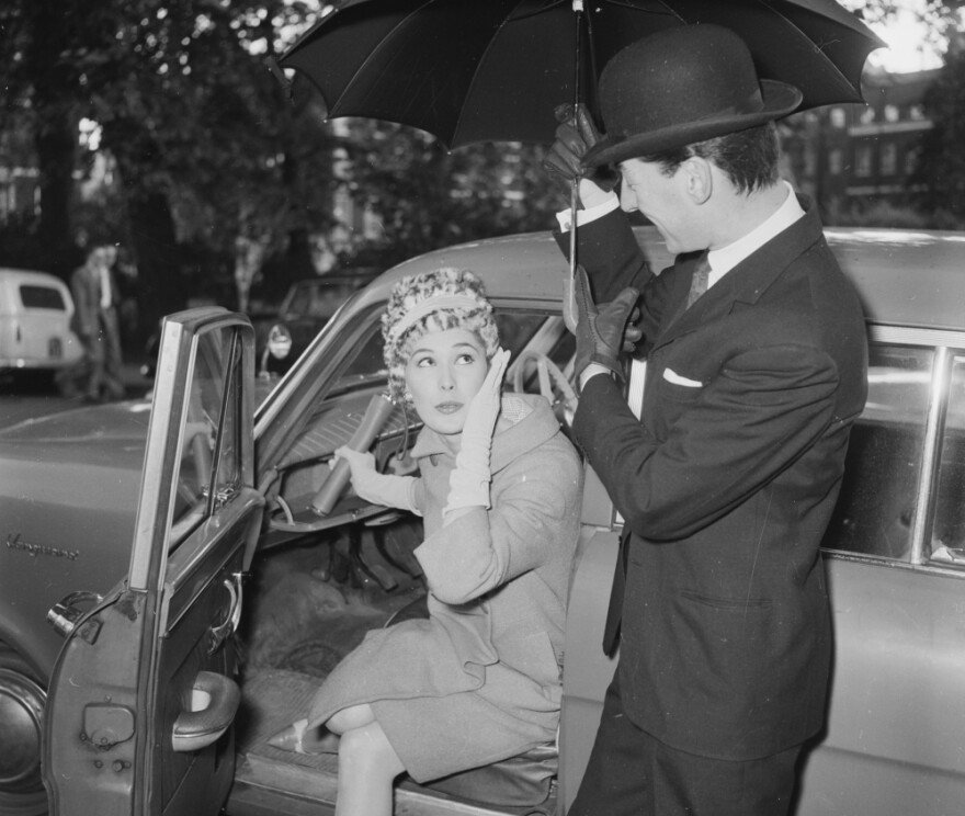 """Oh dear, the car doesn't seem to recognize me."" (1960 file photo from the U.K.)"