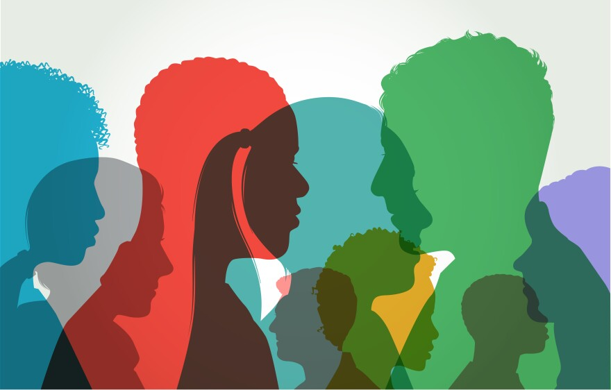 Colourful overlapping silhouettes of head profiles.