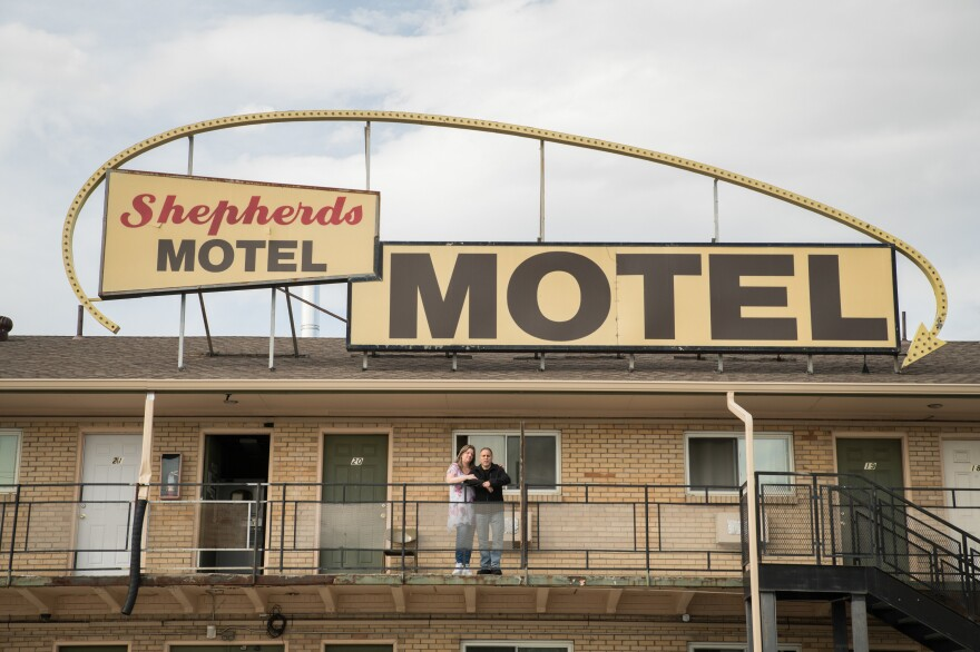 Office manager Shannin Hamilton (left) of the Shepherds Motel in Denver and Orlando Martinez, co-owner, say that as the coronavirus pandemic begins to cause economic strain in the U.S., the motel's guests have started asking for help paying for rooms.