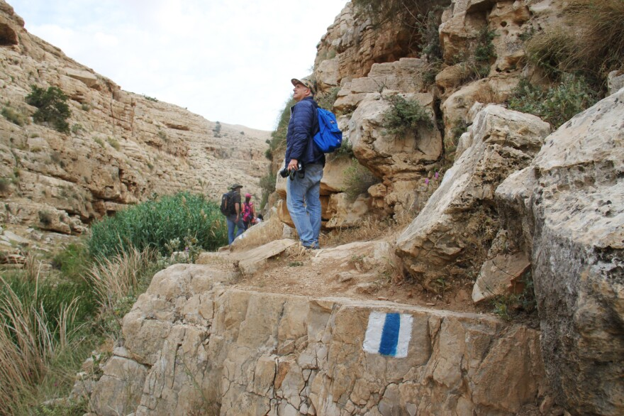 Ibrahim Habash walks with one of the many Palestinian recreational hiking groups that have sprung up largely in the last decade. The Israeli trails network, with its blue and white markings, extends into the West Bank, and Israeli and Palestinian hikers often cross paths on the same trails.