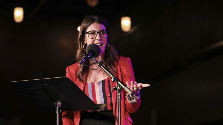 <em>HQ Words</em> host Anna Roisman leads a word game <em>Ask Me Another</em> at the Bell House in Brooklyn, New York.