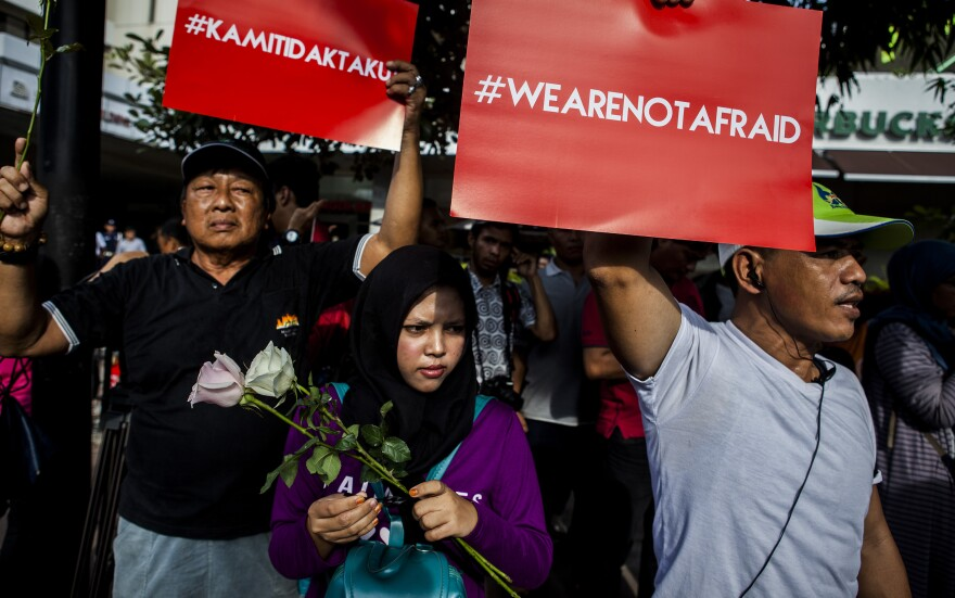 """People hold placards reading """"We Are Not Afraid"""" during a rally held one day after the terrorist attack in Jakarta."""