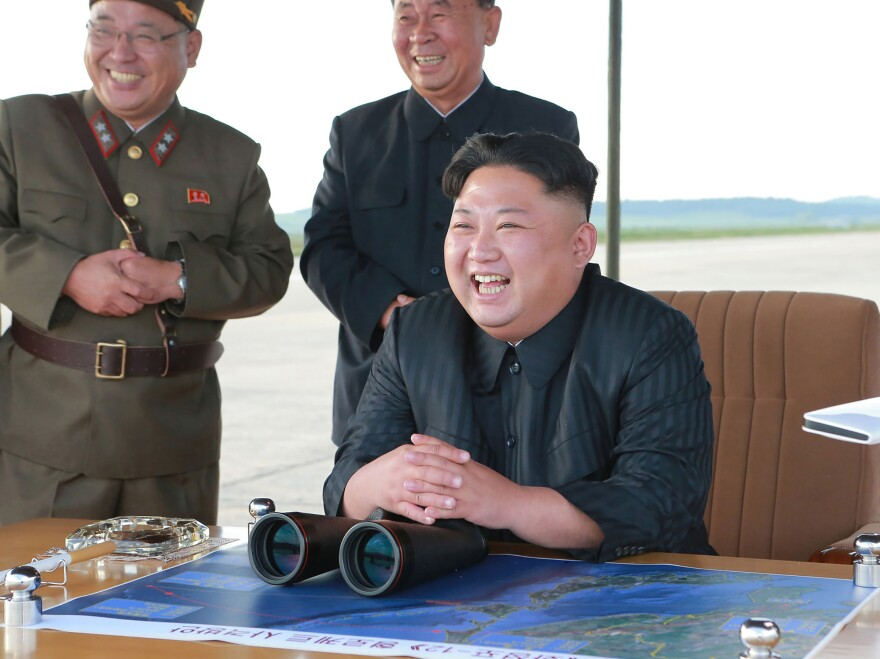 An undated picture released by North Korea's official Korean Central News Agency on Sept. 16 shows North Korean leader Kim Jong Un inspecting a launching drill of the Hwasong-12 ballistic missile at an undisclosed location. Kim vowed to complete North Korea's nuclear force despite sanctions, state media reported.