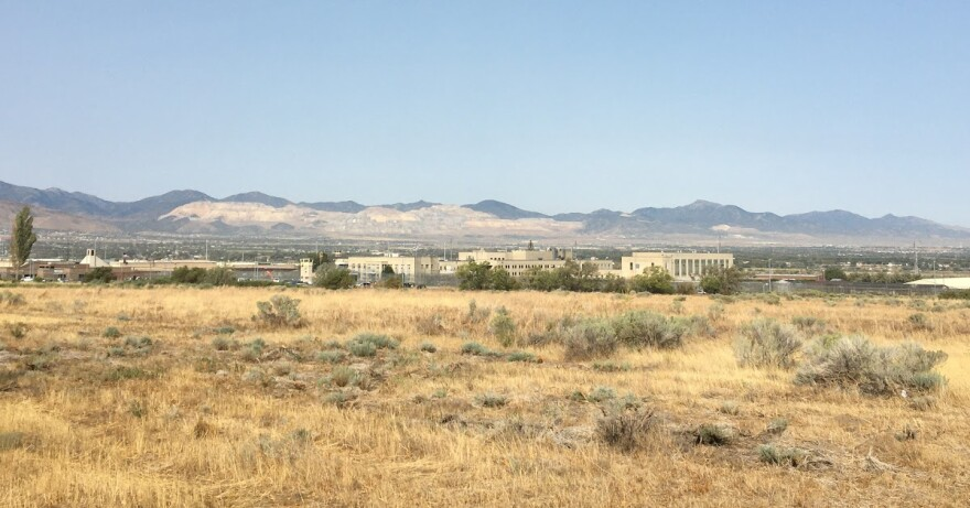 A photo of the Utah State Prison location with mountains in the background.