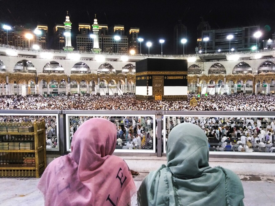 Worshipers watch as others circle the Kaaba, Islam's holiest shrine, at the Grand Mosque.