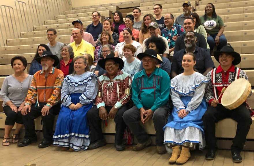 After performing at Cahokia Mounds, members of the Chickasaw Nation Dance Troupe pose with descendants of the Chickasaw tribe who live in the St. Louis area.