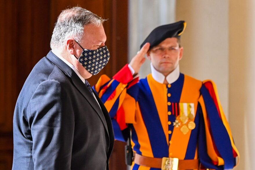 US Secretary of State Mike Pompeo walks past a Swiss Guard as he arrives at San Damaso courtyard in The Vatican for meetings with The Vatican's Secretary of State, and The Vatican's Secretary for Relations with States.