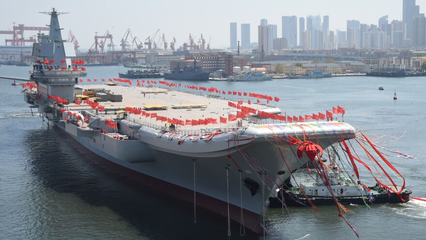 China's first domestically developed aircraft carrier is launched in Dalian, Liaoning Province, Wednesday.