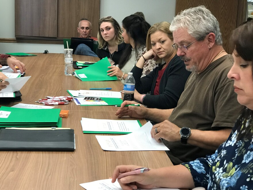 Peer Recovery Support Specialist Roger Dodd (right) speaks to fellow members of PITAR in Petersburg, W.Va. at its October 2019 meeting.