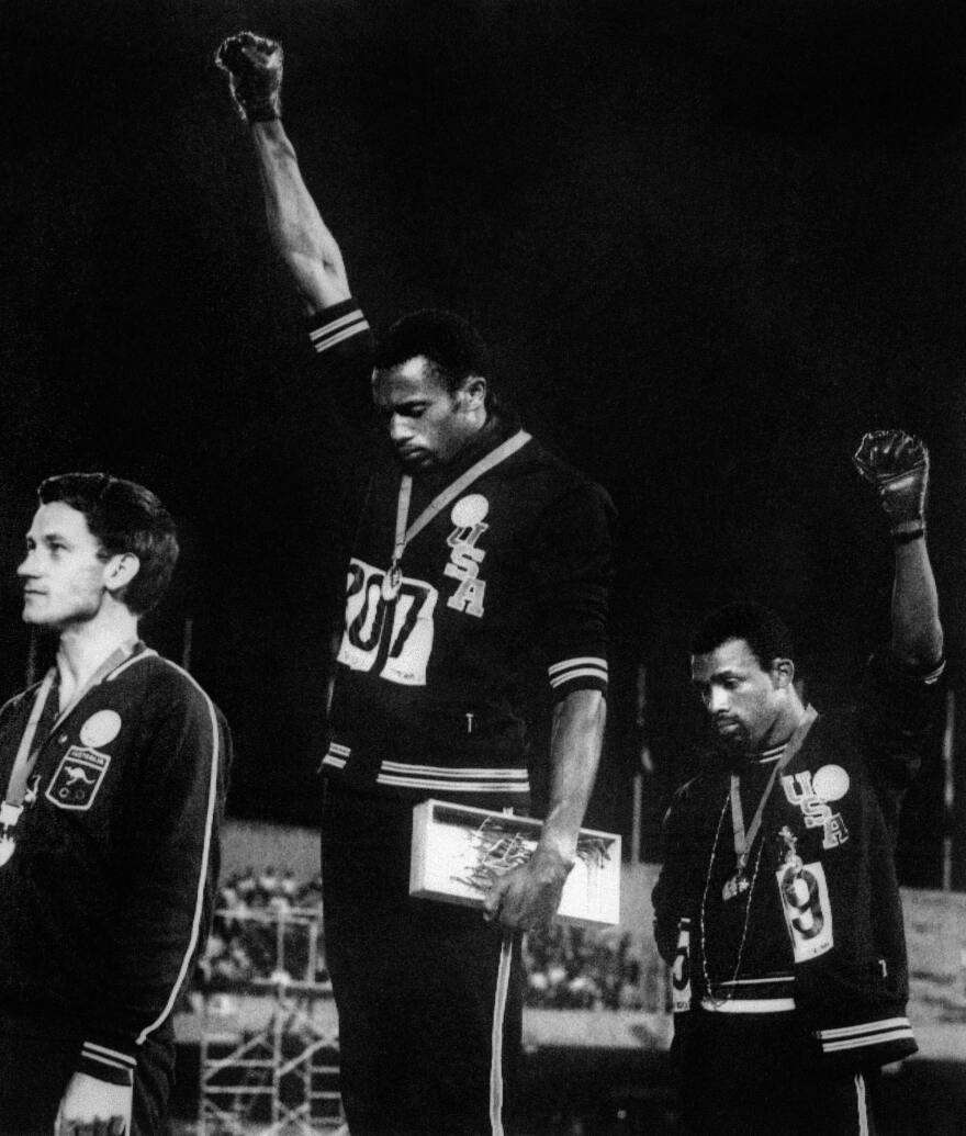U.S. athletes Tommie Smith and John Carlos raise their gloved fists at the Mexico City Olympics in 1968 to express their opposition to racism in the U.S.