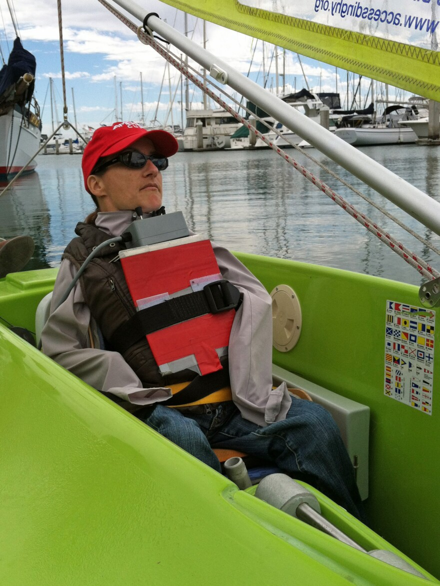 Cristina Rubke is unable to use her arms and legs, so she controls her sailboat using a joystick and levers positioned under her chin.