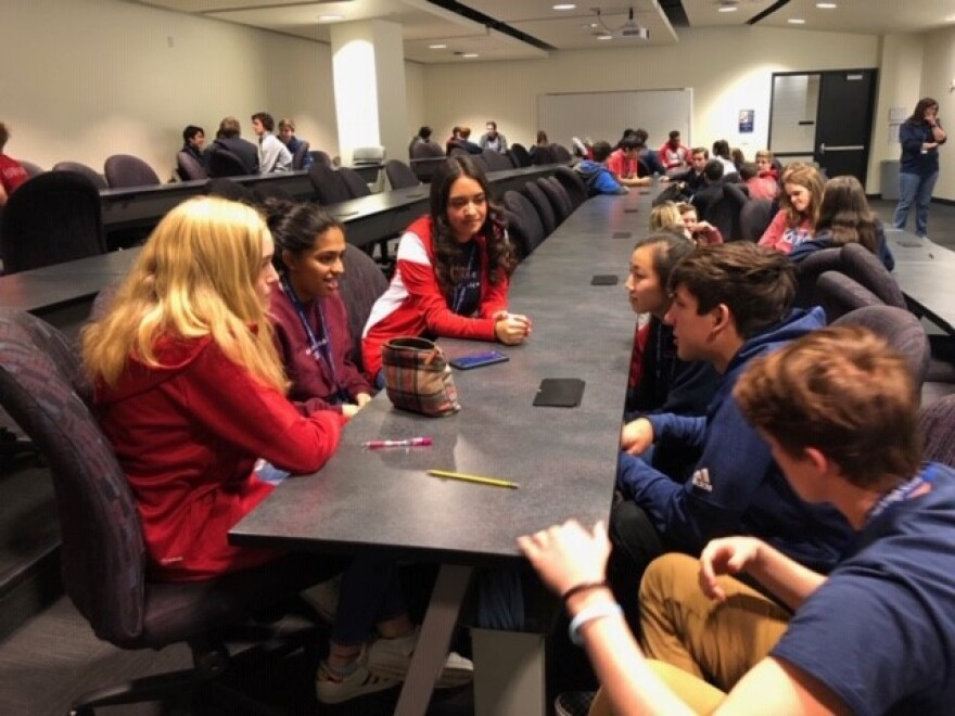 Students at John Paul II High School in Dallas discuss immigration during the campus-wide Solidarity Week.