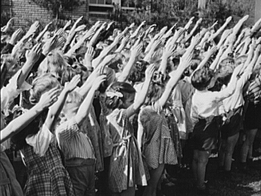Schoolchildren in Southington, Conn., recite the Pledge of Allegiance in 1942, around the time the custom of placing a hand over the heart replaced the original hand position.