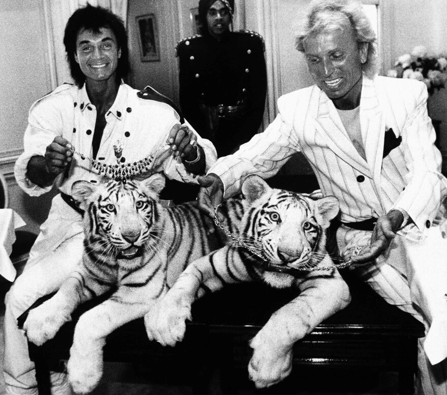 Siegfried Fischbacher, right, and Roy Horn, pose with their white tigers Neva and Vegas in New York in June 1987.
