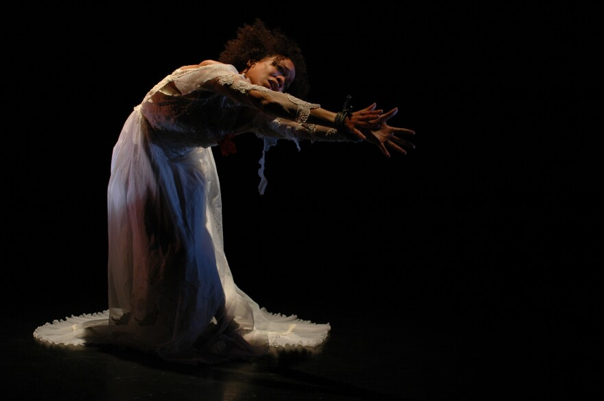 """Gesel Mason performs David Roussève's """"Jumping the Broom"""" as part of her performance project <em>No Boundaries: Dancing the Visions of Contemporary Black Choreographers.</em>"""