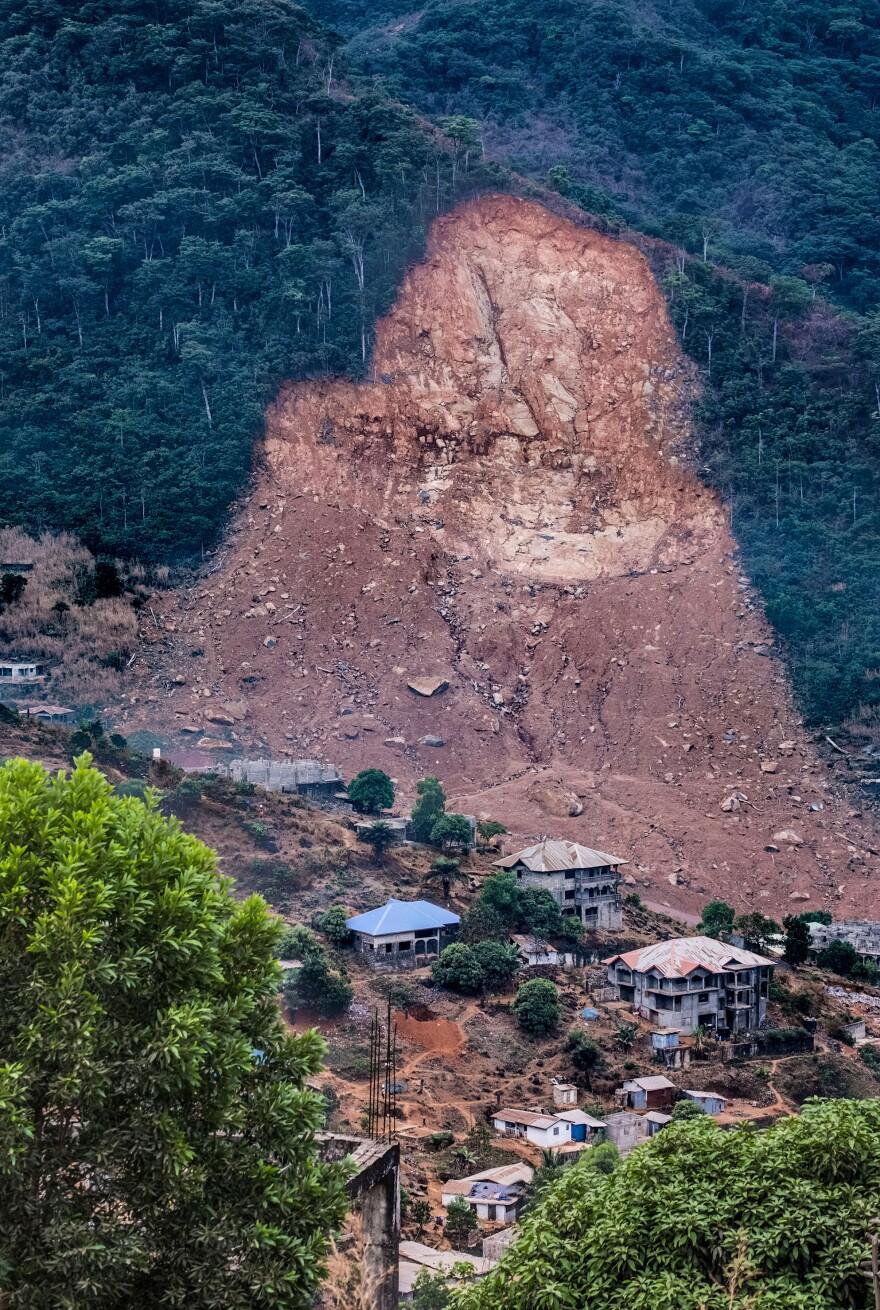 Torrential rains last August caused the massive landslide in Regent, Sierra Leone, killing over 1,000 people. Above: The site of the mudslide.