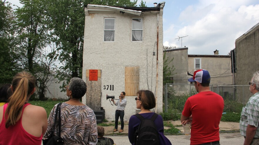 Historian Patrick Grossi stops in front of 3711 Melon St. during a walking tour through Mantua. On Saturday, this house will be torn down — and will receive an elaborate memorial service.