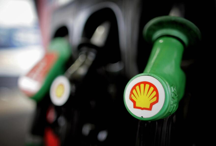The Royal Dutch Shell logo is shown on a gas pump at a London Shell garage.