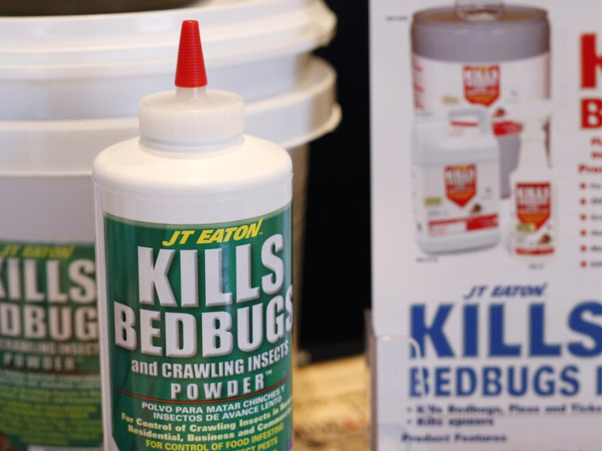 Bedbug insecticide products are displayed at a bedbug summit in Illinois.