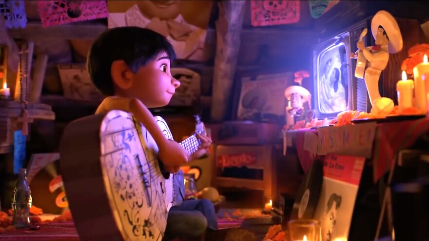 A scene from the Disney-Pixar animated movie <em>Coco</em>, about a young boy, Miguel, who dreams of becoming a musician despite his parents' objections.