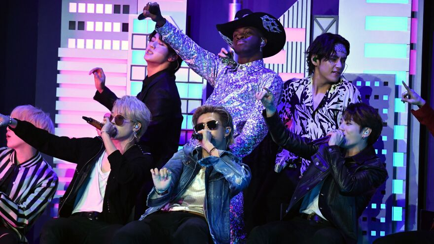 """Lil Nas X (center) with members of BTS during his performance of """"Old Town Road."""""""