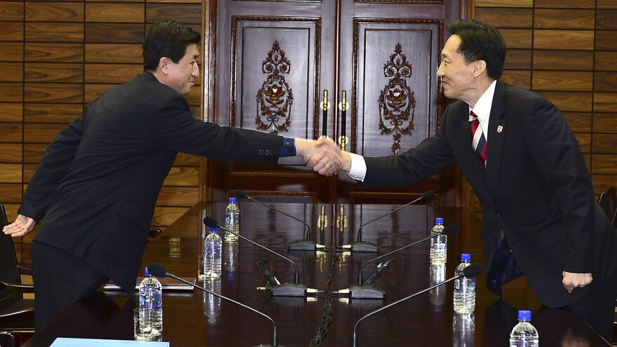In this photo released by South Korean Unification Ministry, Lee Duk-haeng, right, the head of South Korea's working-level delegation, shakes hands with his North Korean counterpart, Park Yong Il, during their meeting at Tongilgak in the North Korean side of Panmunjom on Feb. 5. On Wednesday, the two sides are scheduled to hold their highest-level talks in years.