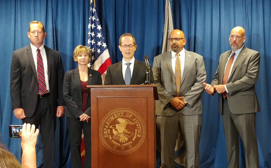 U.S. Attorney Ben Glassman is flanked by representatives of the DEA and HHS.