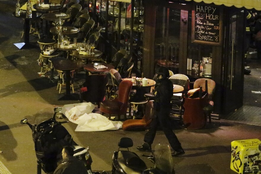 A white sheet covers a victim outside a restaurant in central Paris.