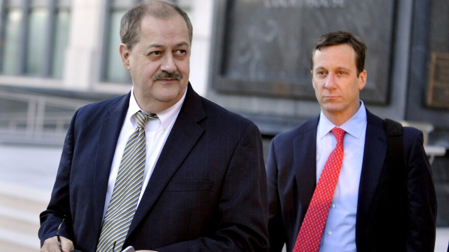Former Massey Energy CEO Don Blankenship, left, walks out of the Robert C. Byrd U.S. Courthouse on Nov. 24, 2015, after the jury deliberated for a fifth full day in his trial in Charleston, W.Va.