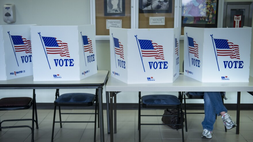 A citizen votes on a paper ballot during the final day of early voting Monday in Lancaster, Ohio.