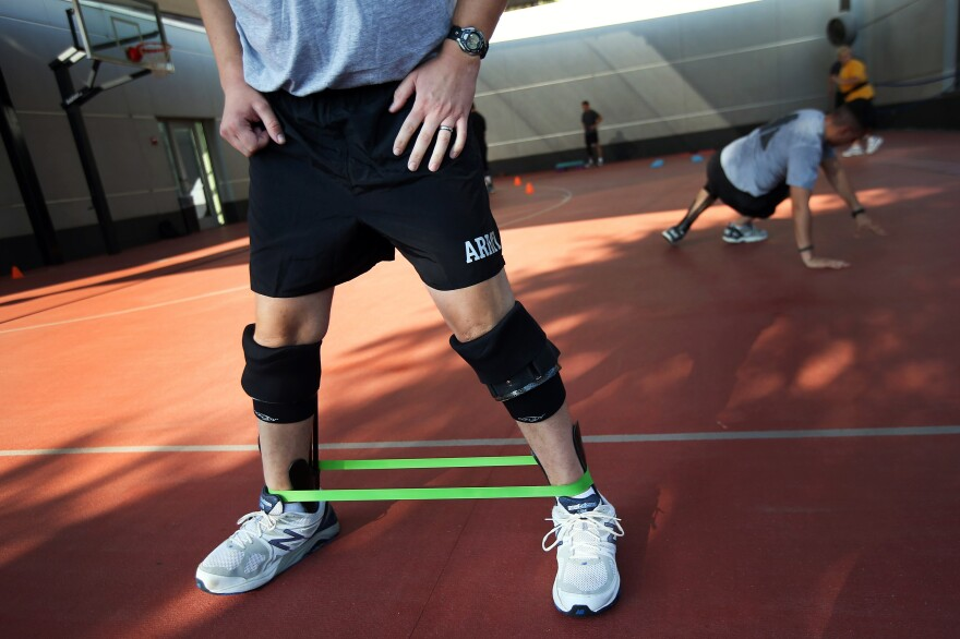 Soldiers participate in physical therapy while using a prosthetic brace called the Intrepid Dynamic Exoskeletal Orthosis (IDEO), which allows them to use and strengthen severely injured legs.