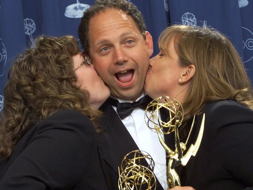 Rob Burnett celebrates with Barbara Gaines (left) and Maria Pope (right) after winning an Emmy Award for his work on the <em>Late Show with David Letterman</em> in 2000.