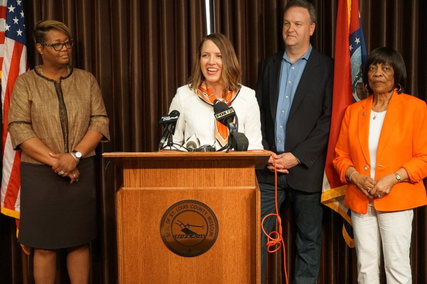 Lisa Picker of the Women's Foundation of Greater St. Louis speaks at a press conference on Tuesday June 4, 2019, with St. Louis County Executive Sam Page.