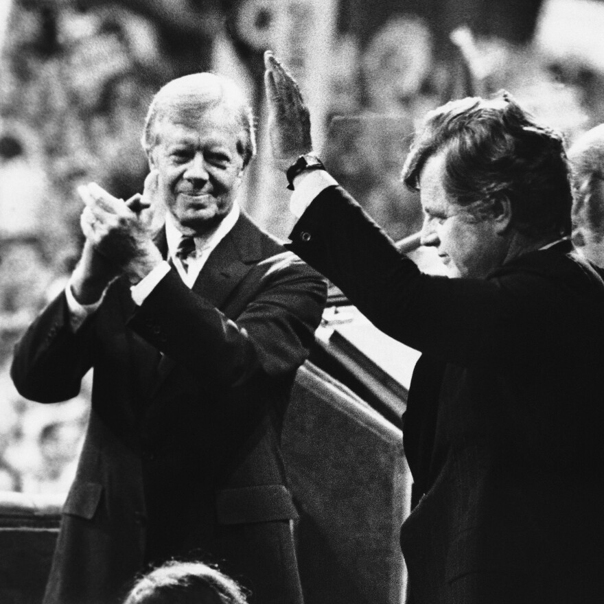 President Jimmy Carter applauds as Sen. Edward Kennedy waves to cheering Democratic National Convention delegates in New York's Madison Square Garden, Aug. 14, 1980. Kennedy's vigorous primary challenge contributed to Carter's eventual loss to Ronald Reagan that fall.