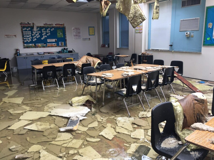 Debris is strewn across a classroom at Kathleen Middle School in Lakeland after a tornado from Tropical Storm Nestor blew off a portion of the school's roof.