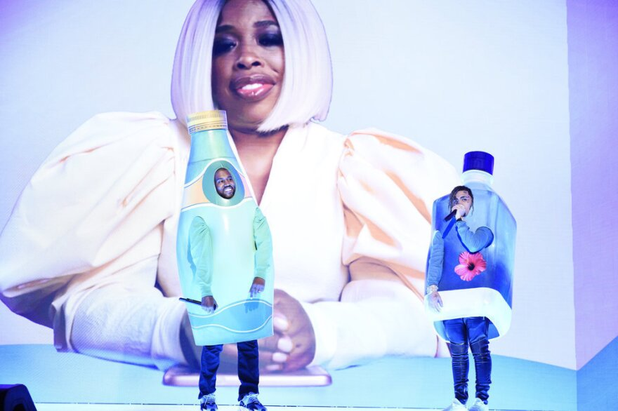 Kanye West and Lil Pump as Perrier and Fiji, respectively, as Adele Givens looms overhead.